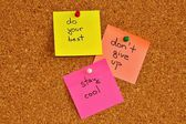 Notice board with three sticky note pads — Stock Photo