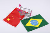 Shopping cart with Brasil and China flag — Stock Photo