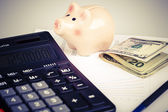 Business Charts with calculator, money, piggy box and pen — Stock Photo