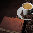 Espresso cup and an old leather book — Stock Photo