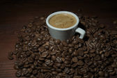 Brown coffee beans and a cup of espresso — Stockfoto