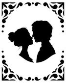 Silhouettes of loving couple — Vector de stock