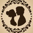 Silhouettes of kissing couple — Stockvectorbeeld