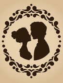 Silhouettes of kissing couple — Vector de stock