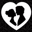Silhouettes of loving couple — Stock Vector #34443815