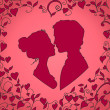 Silhouettes of kissing couple — Stock Vector #42501207
