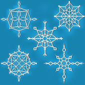 Set of ornate snowflakes against blue background — Stock Vector