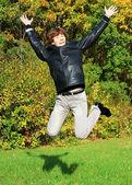 Joyful boy jumping — Stock Photo