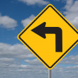 Left Turn Sign with Clouds - Stock Photo