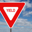Yield Sign with Clouds - Stock Photo