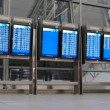 Departure and arrival boards at the airport — Stock Photo