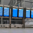 Departure and arrival boards at the airport - Stock Photo