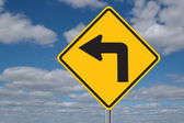 Left Turn Sign with Clouds — Stock Photo