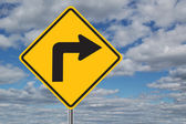 Left Turn Traffic Sign with Clouds — Stock Photo