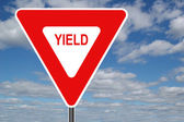 Yield Sign with Clouds — Stock Photo
