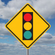 Traffic Light Ahead Sign with Clouds - Stock Photo