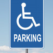 Stock Photo: Standard Disabled Panking Sign with clouds