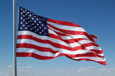 American flag flying — Stock Photo