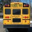 Stock Photo: School bus in neighborhood