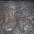 Detail of old door with decorations made by hand — Stock Photo