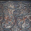 Foto de Stock  : Detail of old door with decorations made by hand