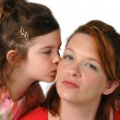 Daughter kissing Mom — Stock Photo