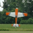 Stock Photo: Radio control plane hovering