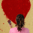 Girl painting a big heart — Stock Photo #12845122