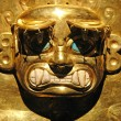 Stock Photo: PeruviAncient Mask made out of Gold