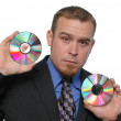 Businessman holding CDs — Stock Photo