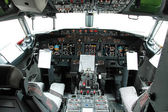Cockpit view of a commertial airplane — Stock Photo