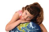 Little girl hugging planet earth — Stock Photo