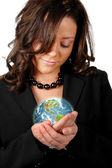 Business woman holding the earth — Stock Photo