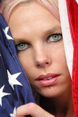 Beautiful blonde with american flag — Stock Photo