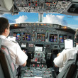 Pilots in cockpit — Stock Photo #12880478