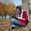 Girl reading the blible - Stock Photo