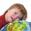 Stock Photo: Boy with down syndrome and earth