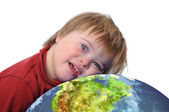 Boy with down syndrome and earth — Stockfoto