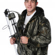 Young hunter with bow — Stock Photo