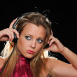 Gorgeous girl with headphones enjoying music — Stock Photo #13110302