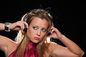 Gorgeous girl with headphones enjoying music — Stock Photo