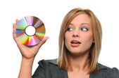 Gorgeous businesswoman holding CD — Stock Photo