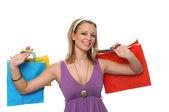Linda menina adolescente sorridente com sacos de compras — Foto Stock