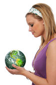 Young woman holding the green earth — Stock Photo