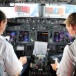 Pilots in the cockpit during a commertial flight — Stock Photo