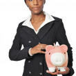 Royalty-Free Stock Photo: Young businesswoman with piggy bank