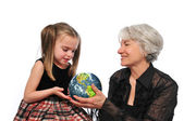 Grandmother and girl holding the earth — Stock Photo