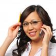 Stock Photo: Beautiful asian young woman with cell phone