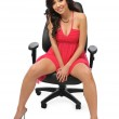 Beautiful asian model posing on a chair — Stock Photo