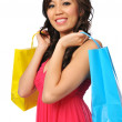 Young asian woman with shopping bags — Stock Photo